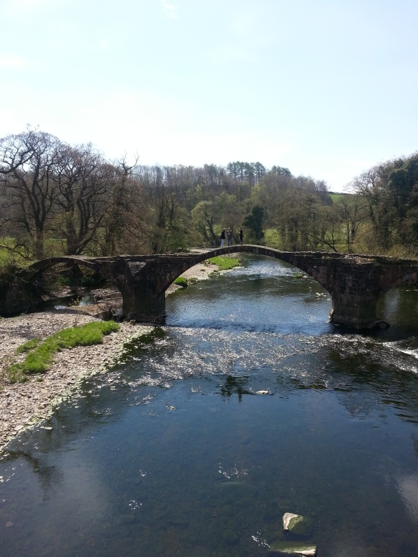 The river Ribble flows through the valley, with ancient bridges