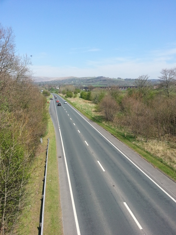 The A59 cuts through the valley, keeping traffic off the quiet country road.