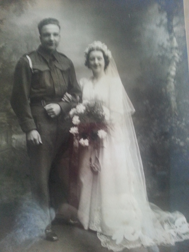 Despite wartime ratioining my mother managed to get the material for this  beutiful wedding dress.